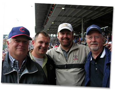 Walt at the Cubs baseball game with clients